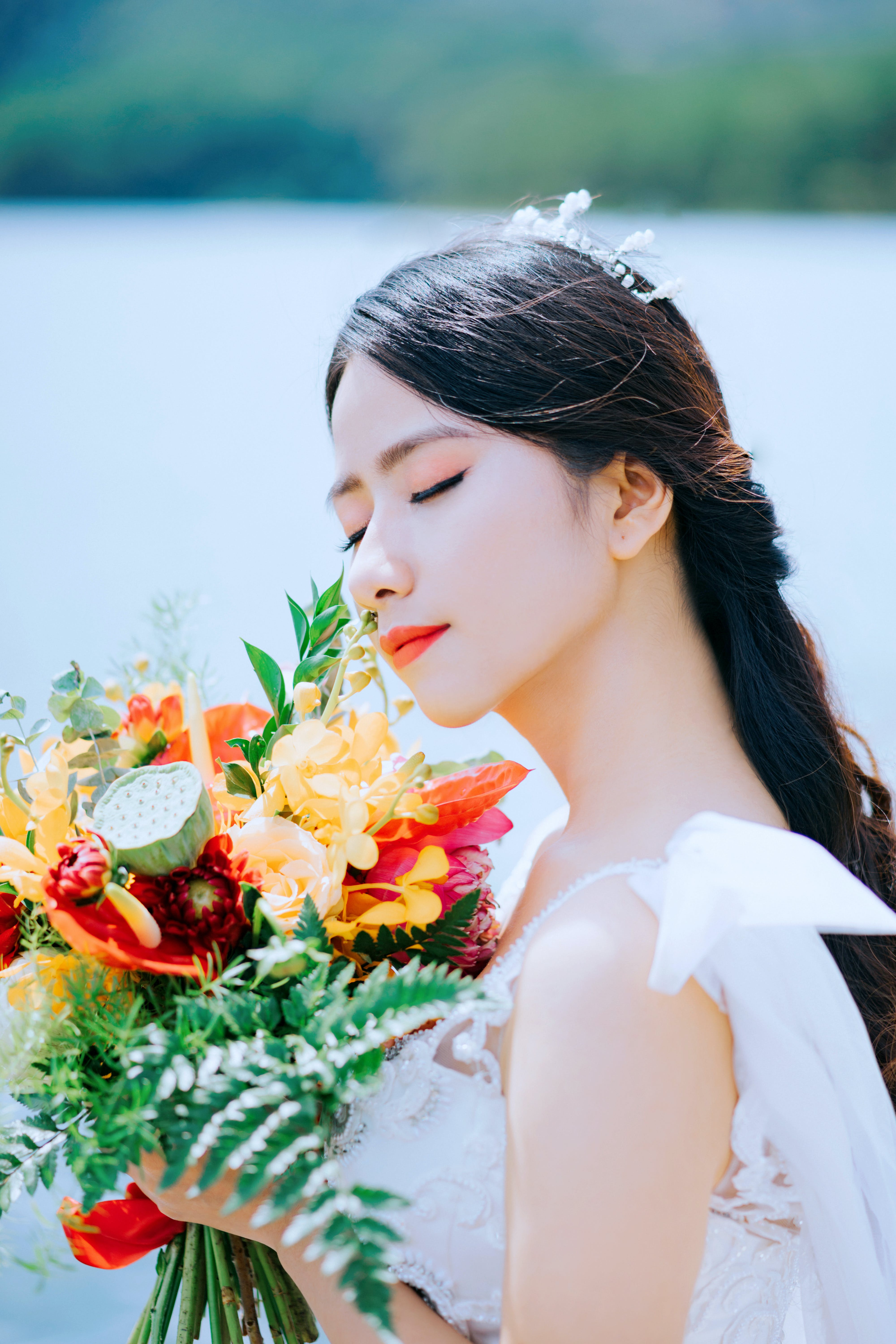Close-Up Photo of Woman Holding Bouquet