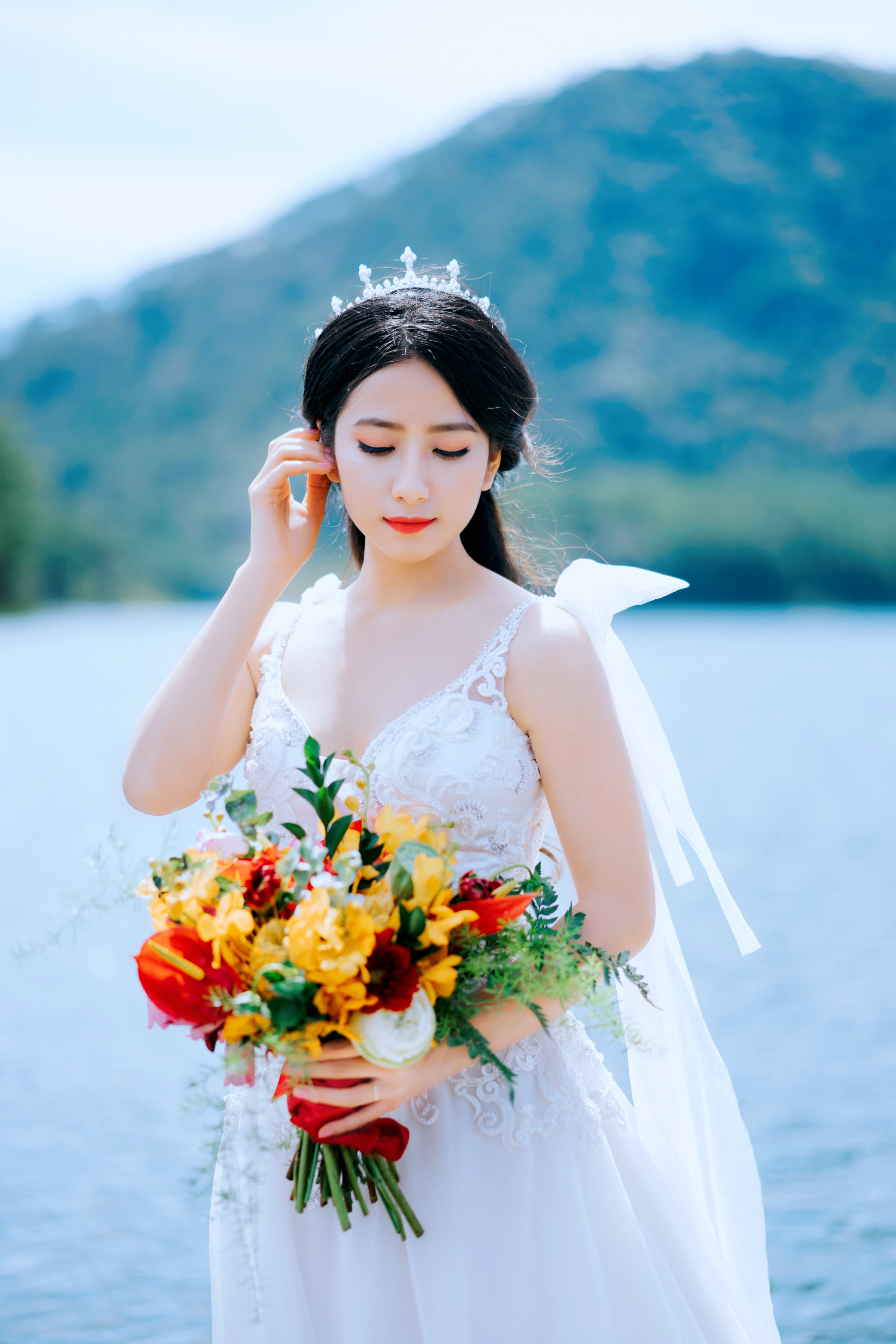 Woman Wearing Wedding Dress While Holding Her Hair