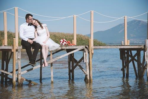 Photo of Couple Sitting On Dock