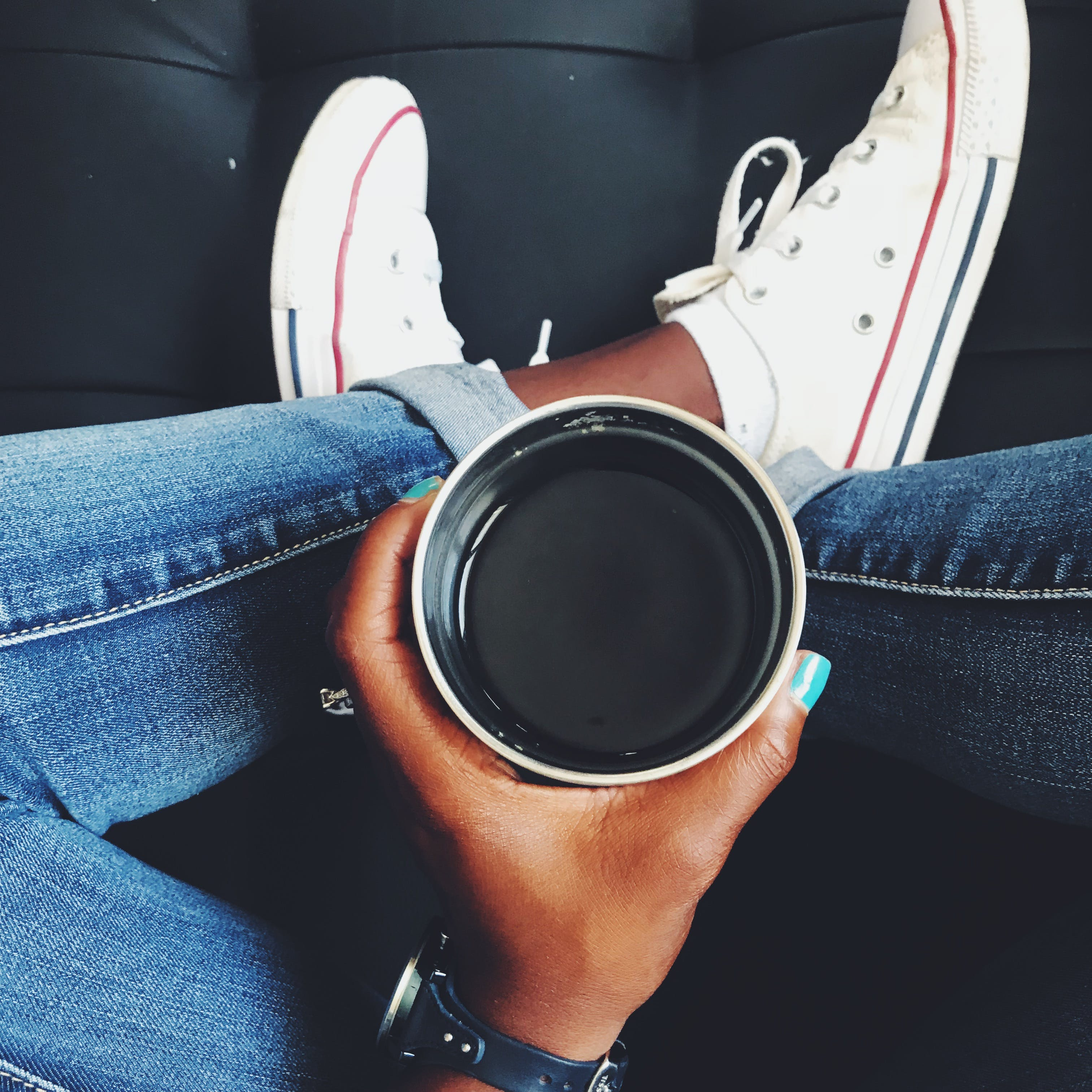 Top View Photo of Person Holding Cup