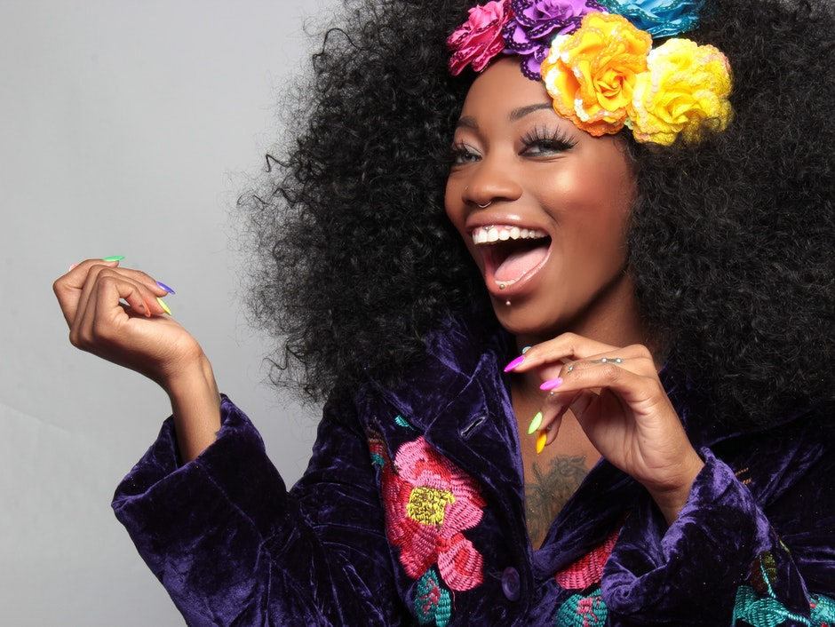 Woman Wearing Yellow Purple and Blue Flower Hair Clipper