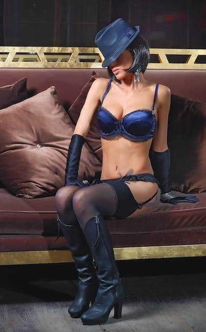 Woman In Blue Bikini Sitting Brown Sofa  Free Stock Photo-3852