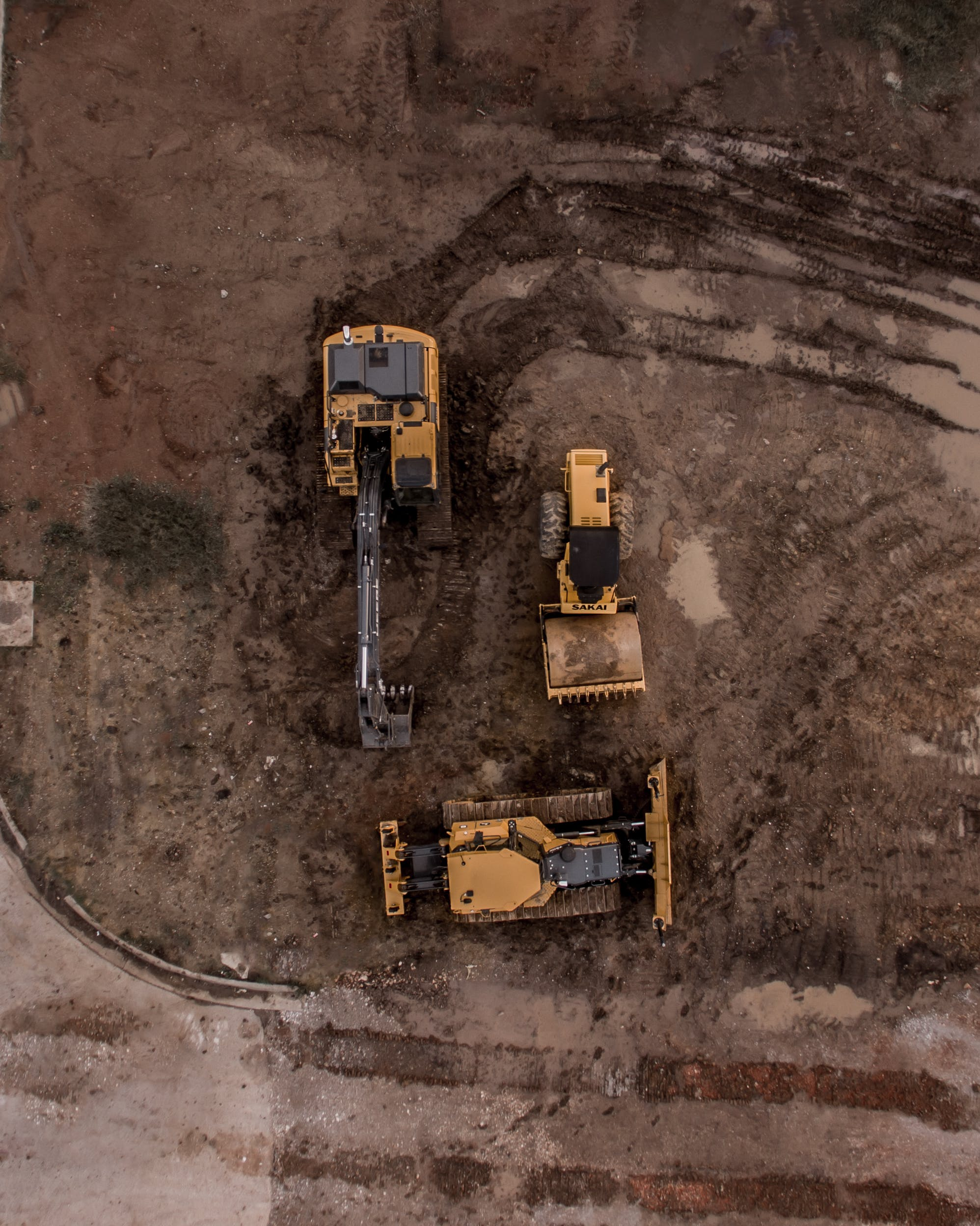 Aerial Photo Of Excavator, Road Roller, And Bulldozer
