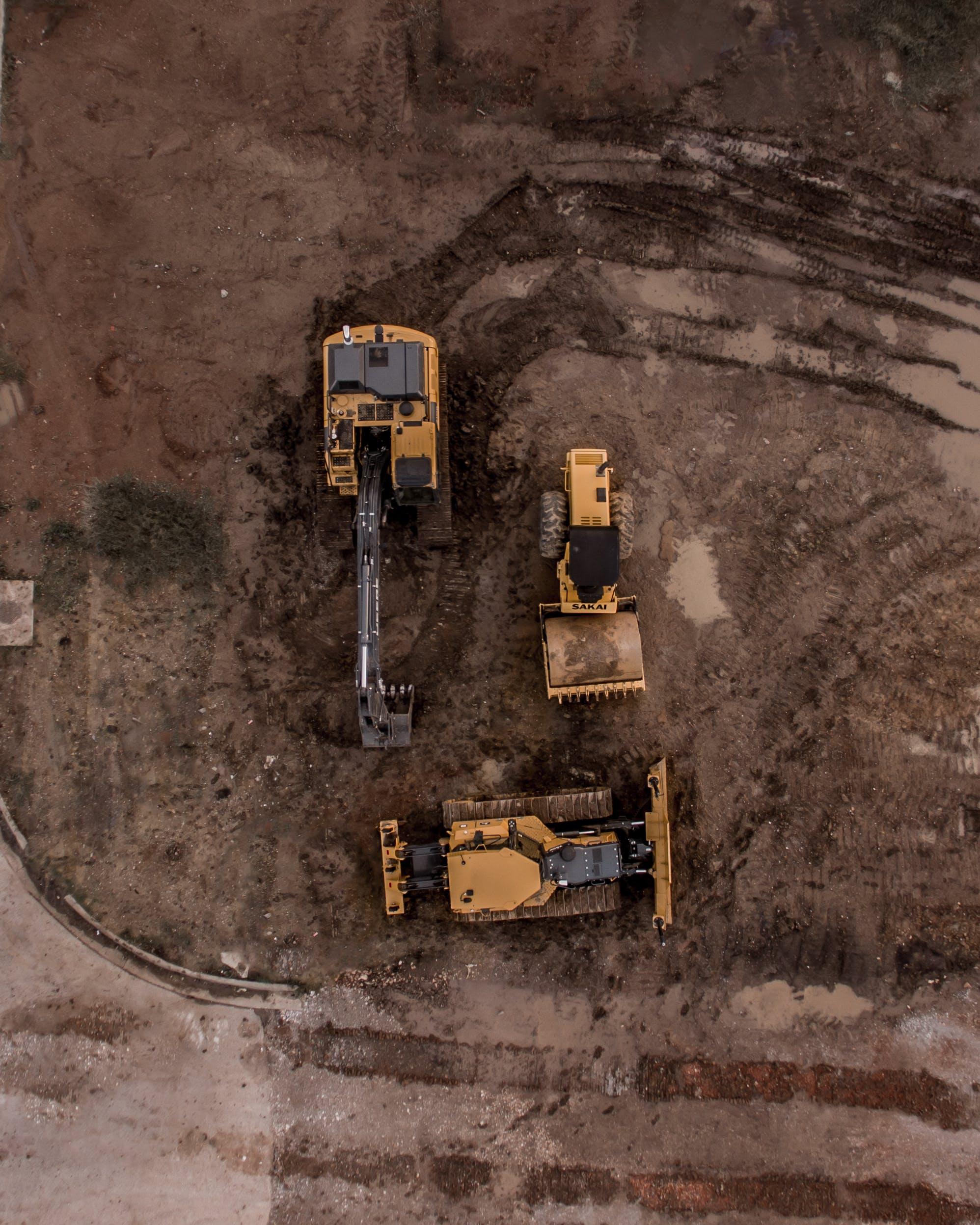 Aerial Photo Of Excavator, Road Roller, And Bulldozer