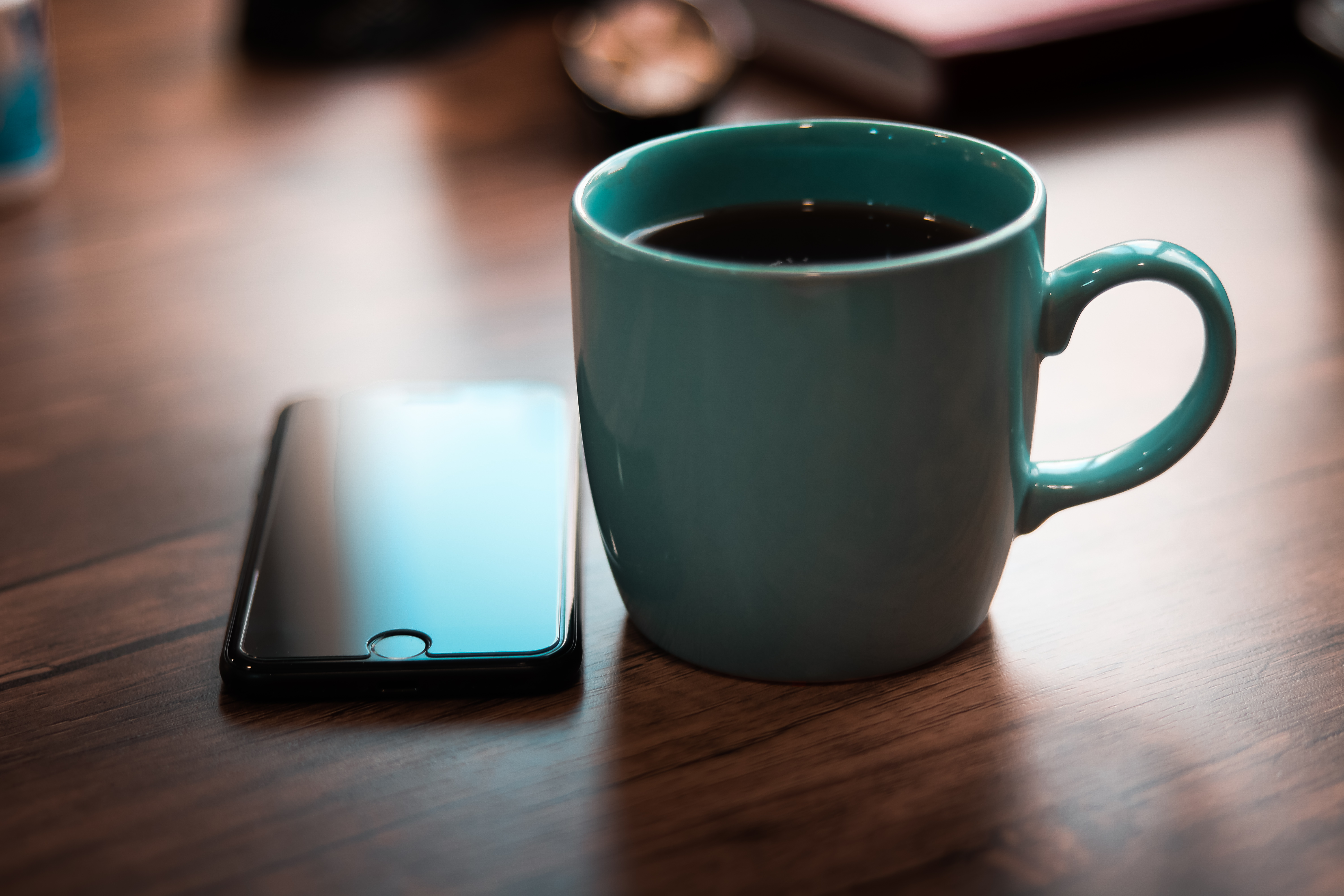Close-Up Photo of Coffee cup Near Iphone