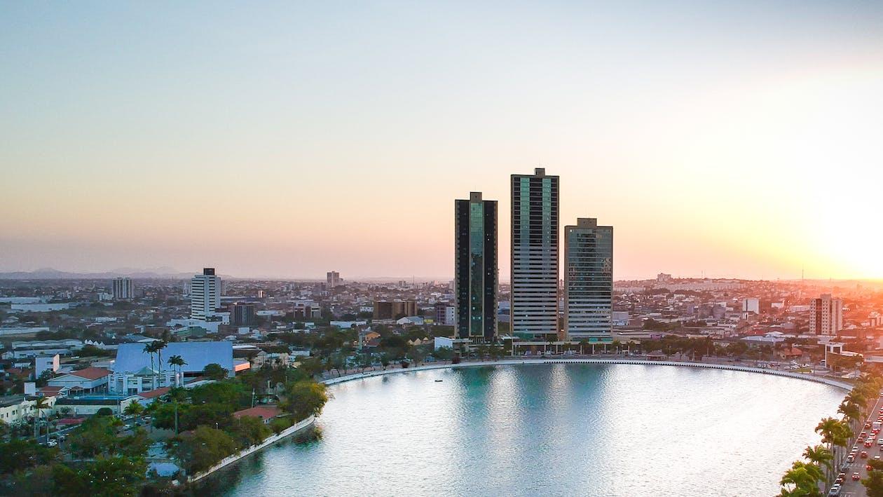 City Buildings Beside Lake