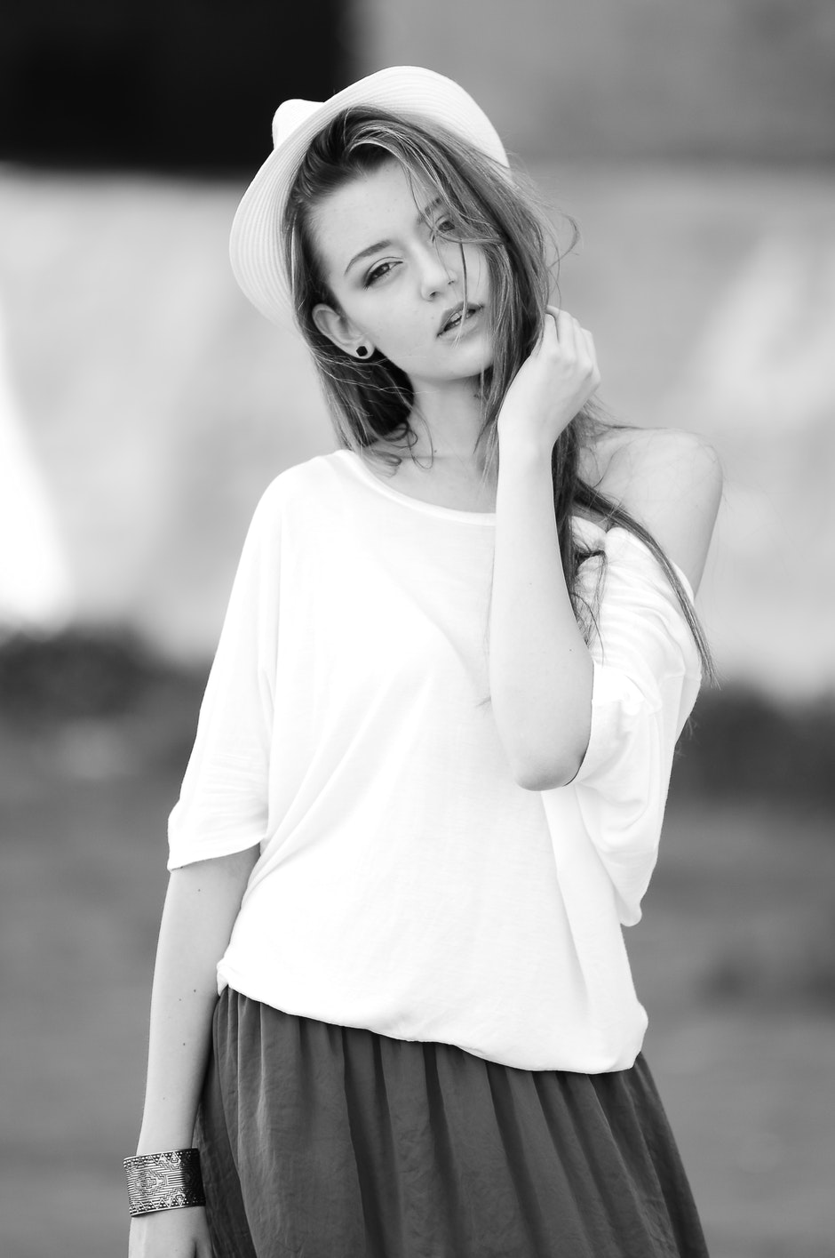 Woman Wearing White Off Shoulder Top in Gray Scale