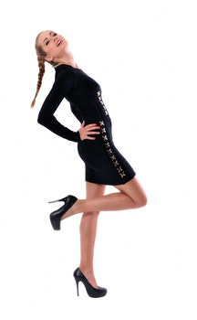 Woman in Black Long Sleeve Mini Dress and Black Platform Stilettos