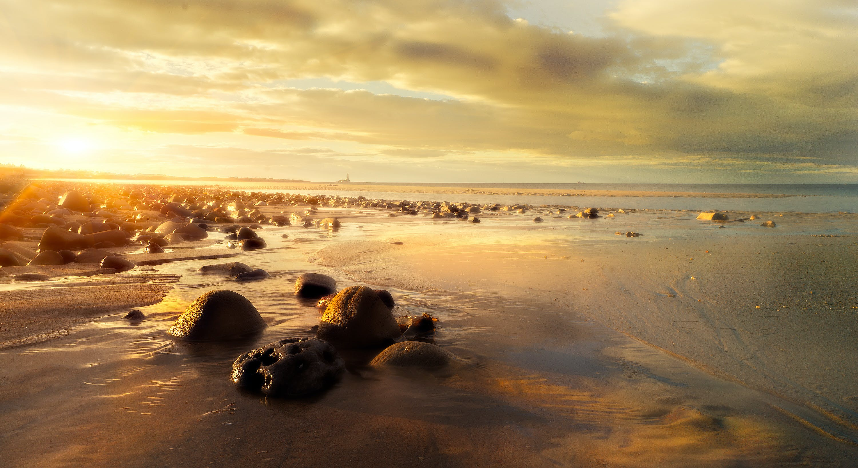 Photo of Rocky Shore During Dusk