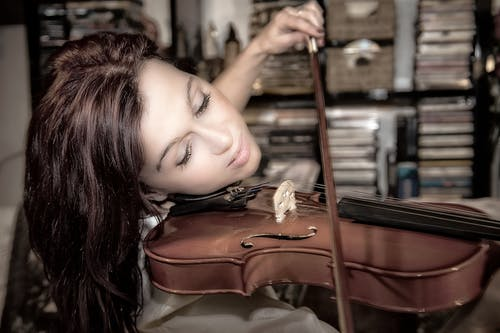 Woman Playing Violin Inside Room