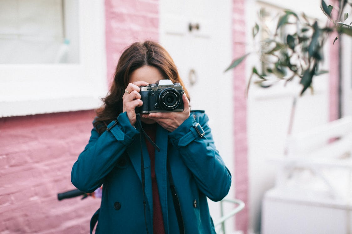 Woman Using Black Dslr Camera
