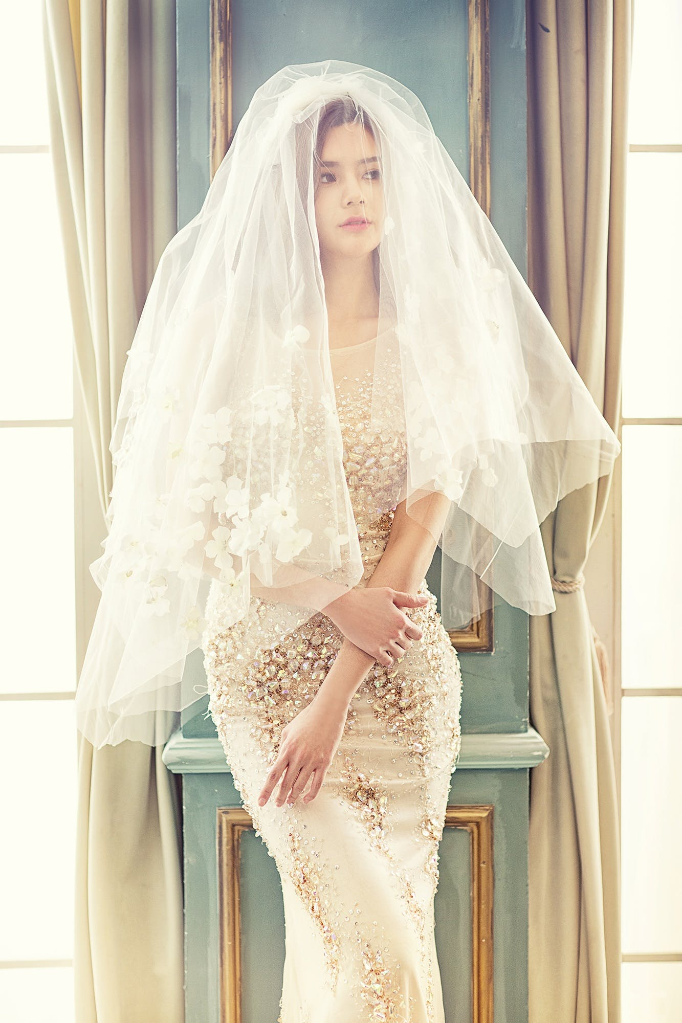 Woman in Brown Tank Bodycon Dress With White Veil Standing
