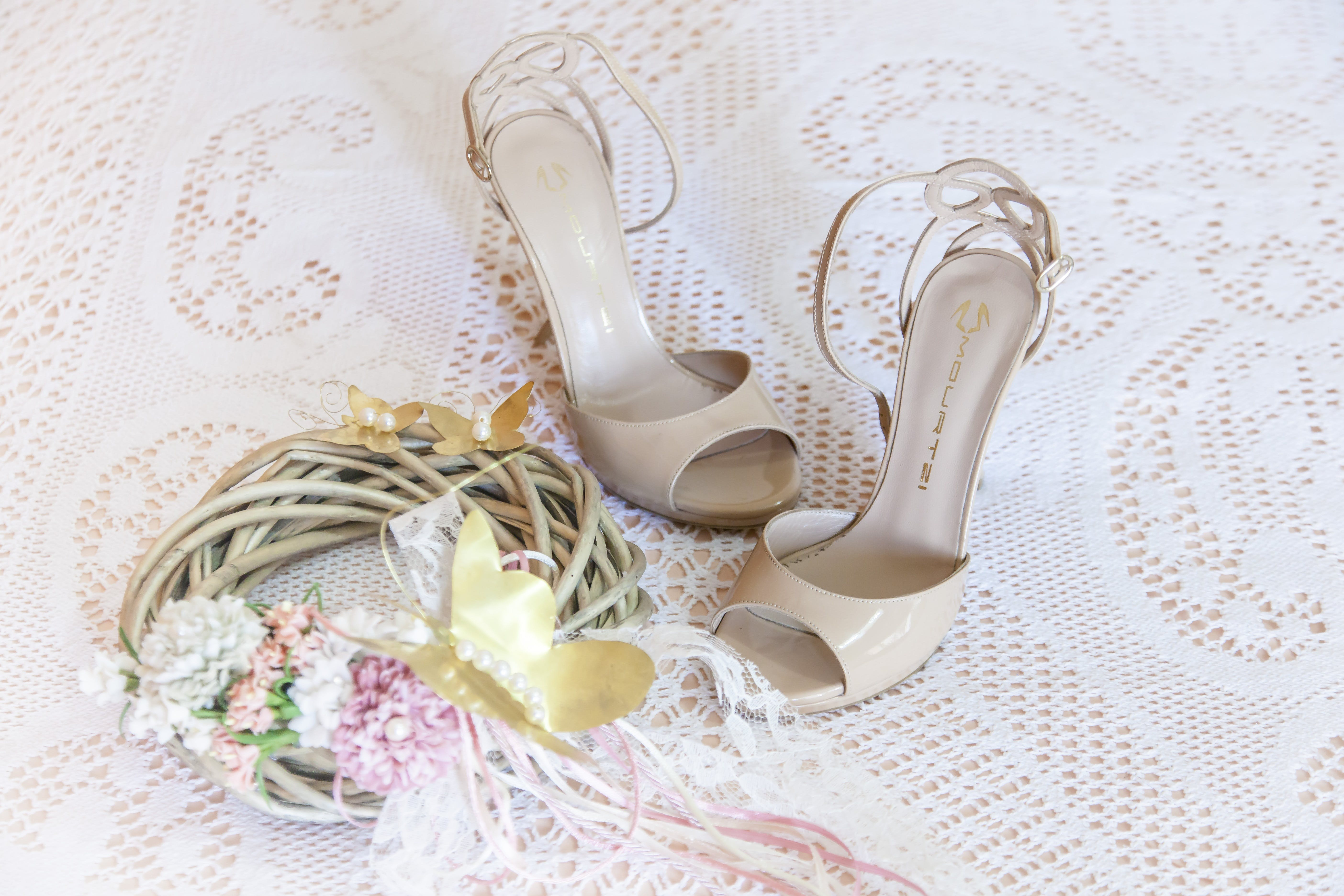 Women's White Stiletto Sandals on White Floral Design Textile