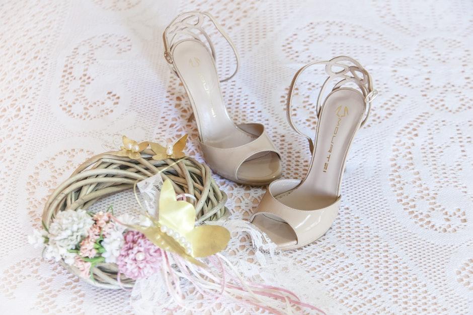 Women's White Stiletto Sandals on White Floral Design Textile