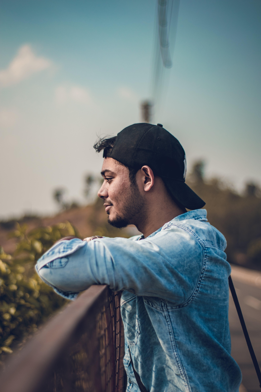 Man Wearing Black Cap Looking Away