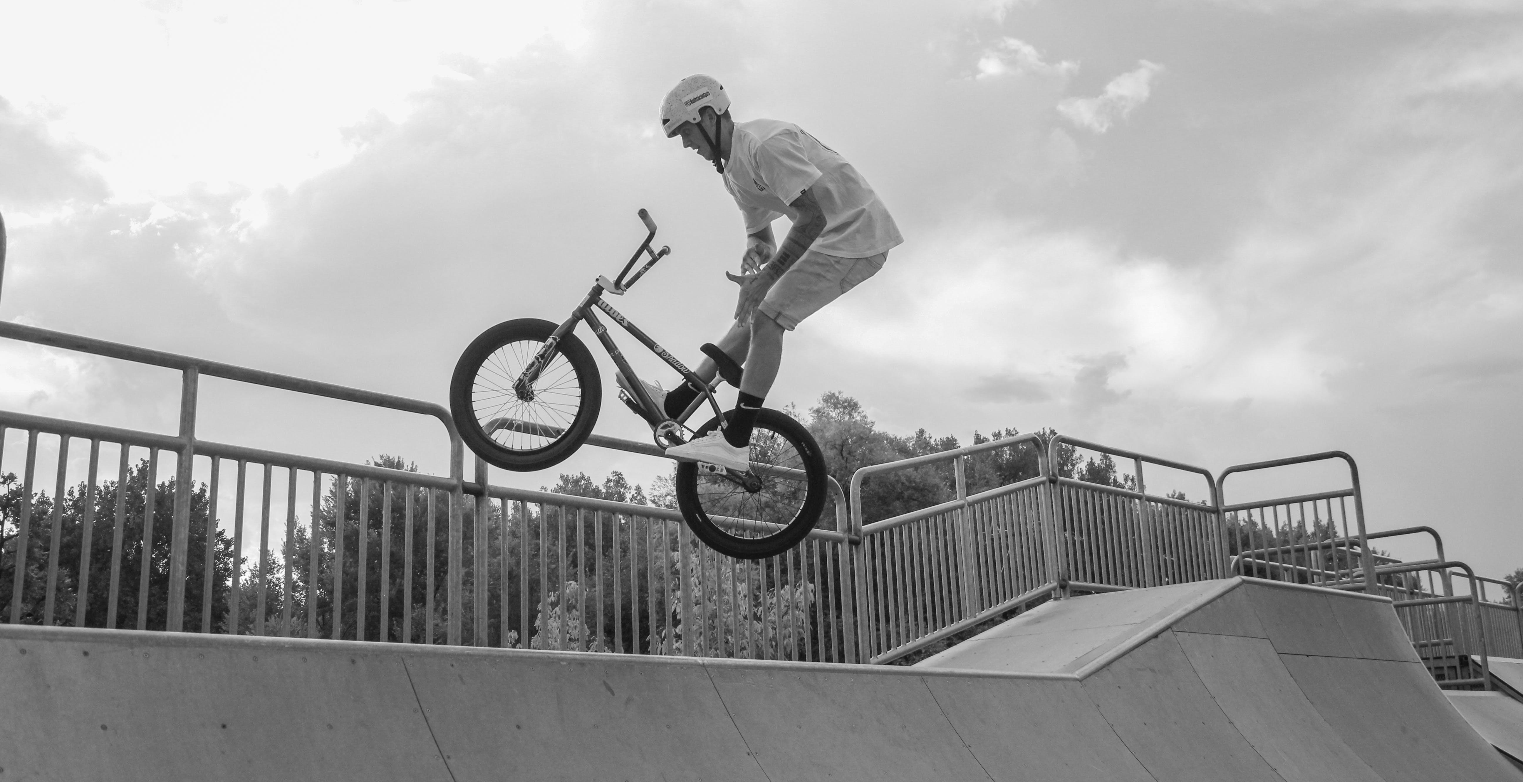 Man Performing Bmx Bike Tricks on Ramp