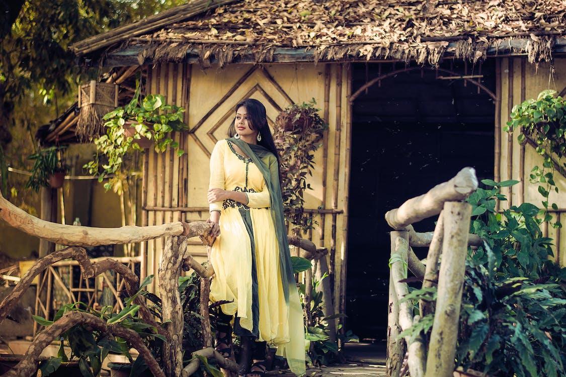 Woman Standing Near House