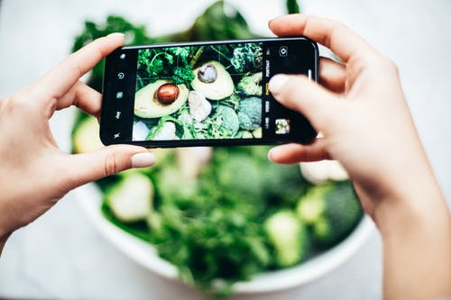 Person Taking Photo Of Bowl Of Vegetables