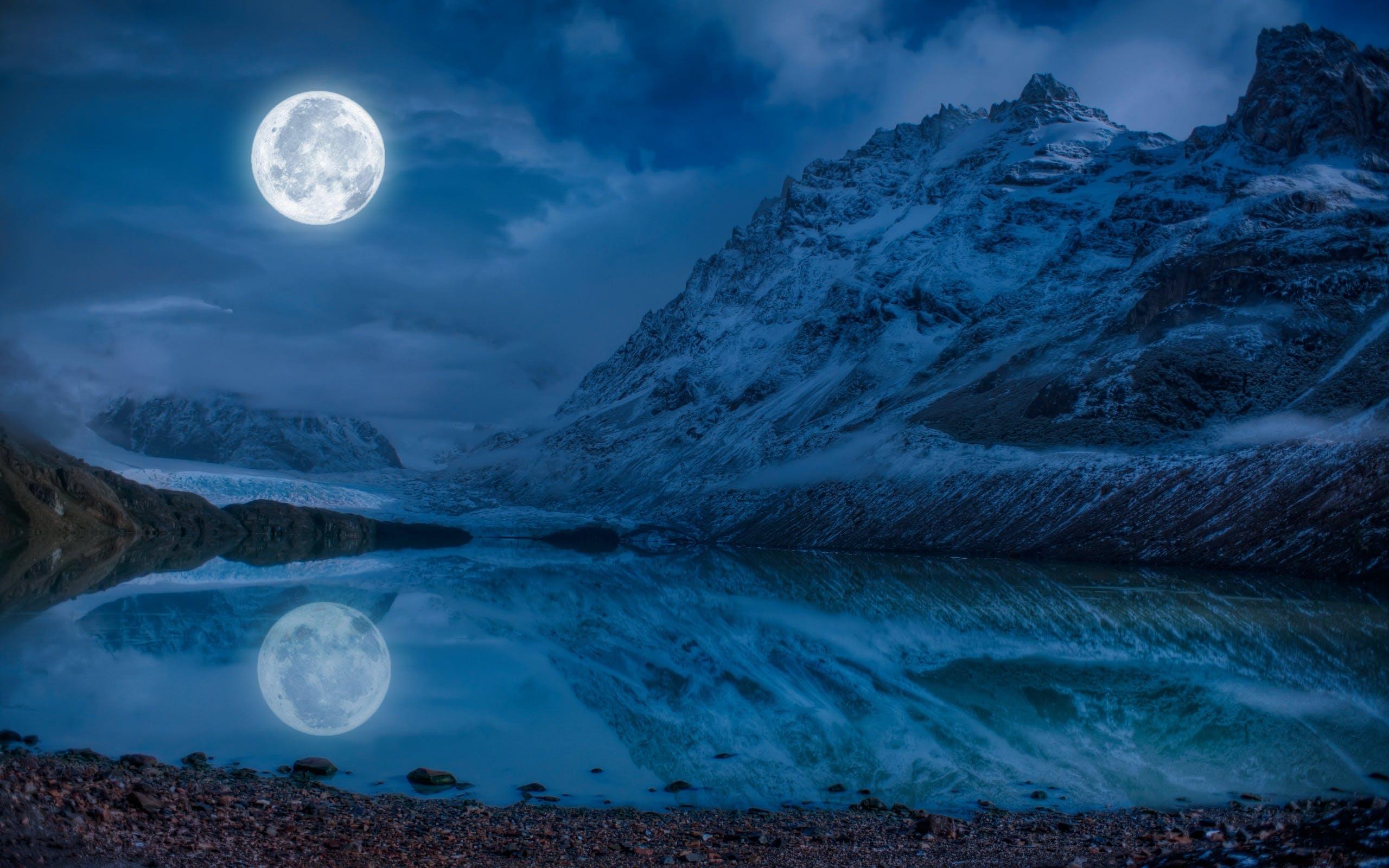 Full Moon Near Snowcap Mountain