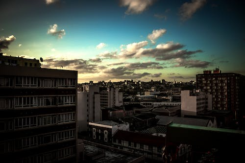 Free stock photo of buildings, cloudscape, dark clouds, wide-angle