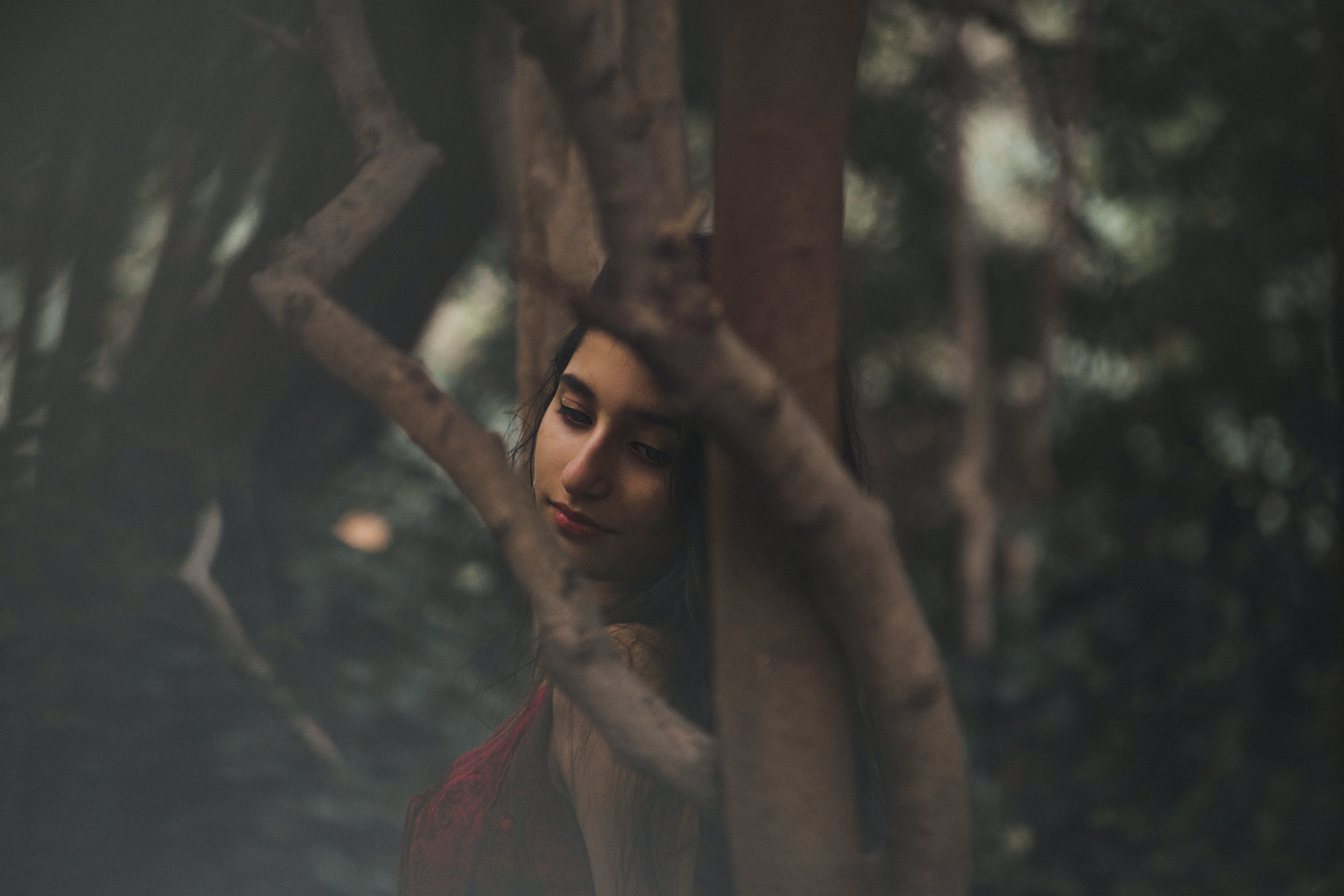 Woman Leaning on Trees