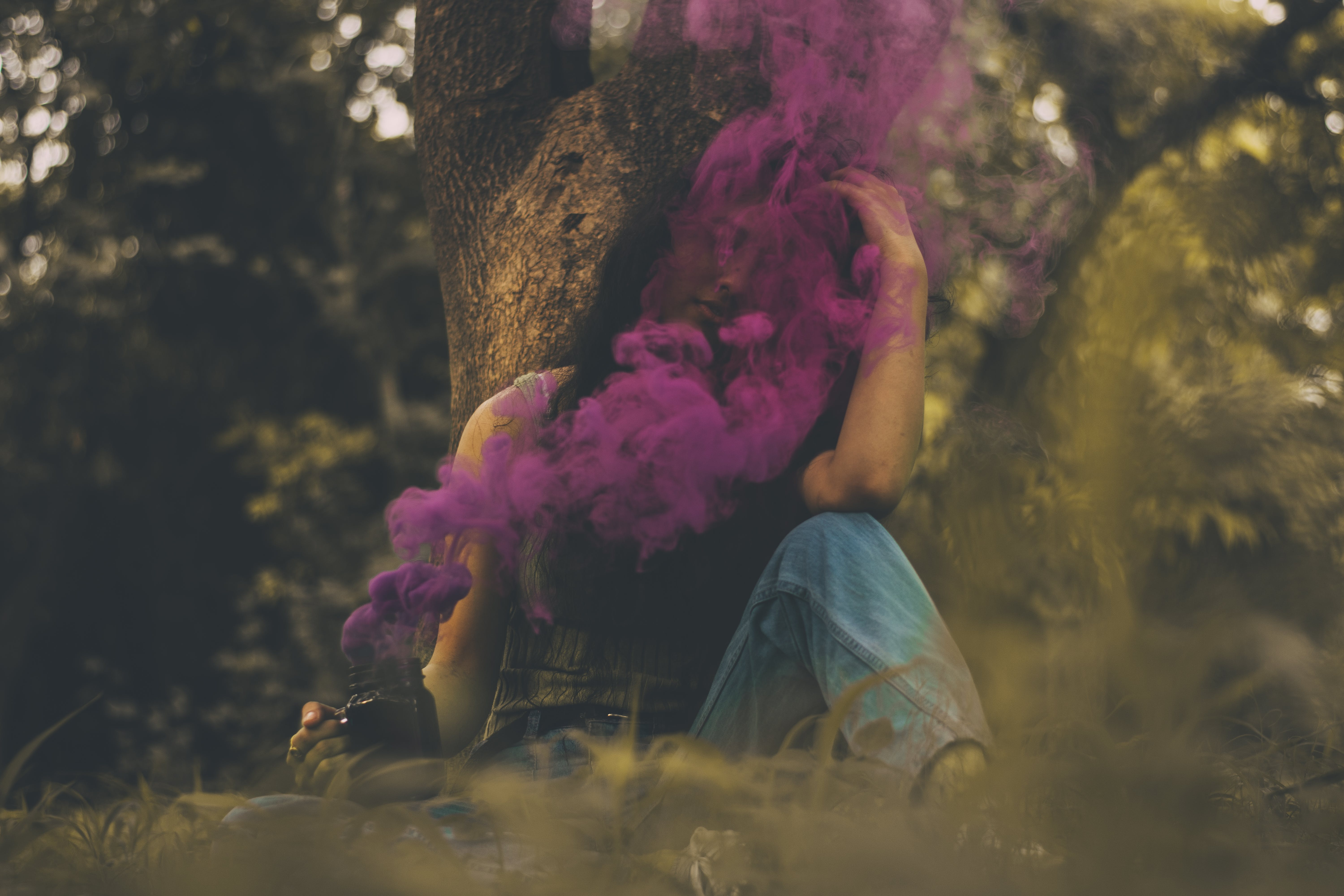Woman Sitting Covered in Pink Smoke