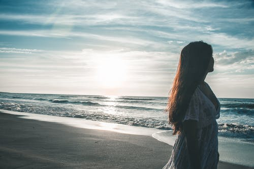 Woman Walking By The Seashore
