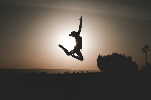 Silhouette Of Person While Jumping