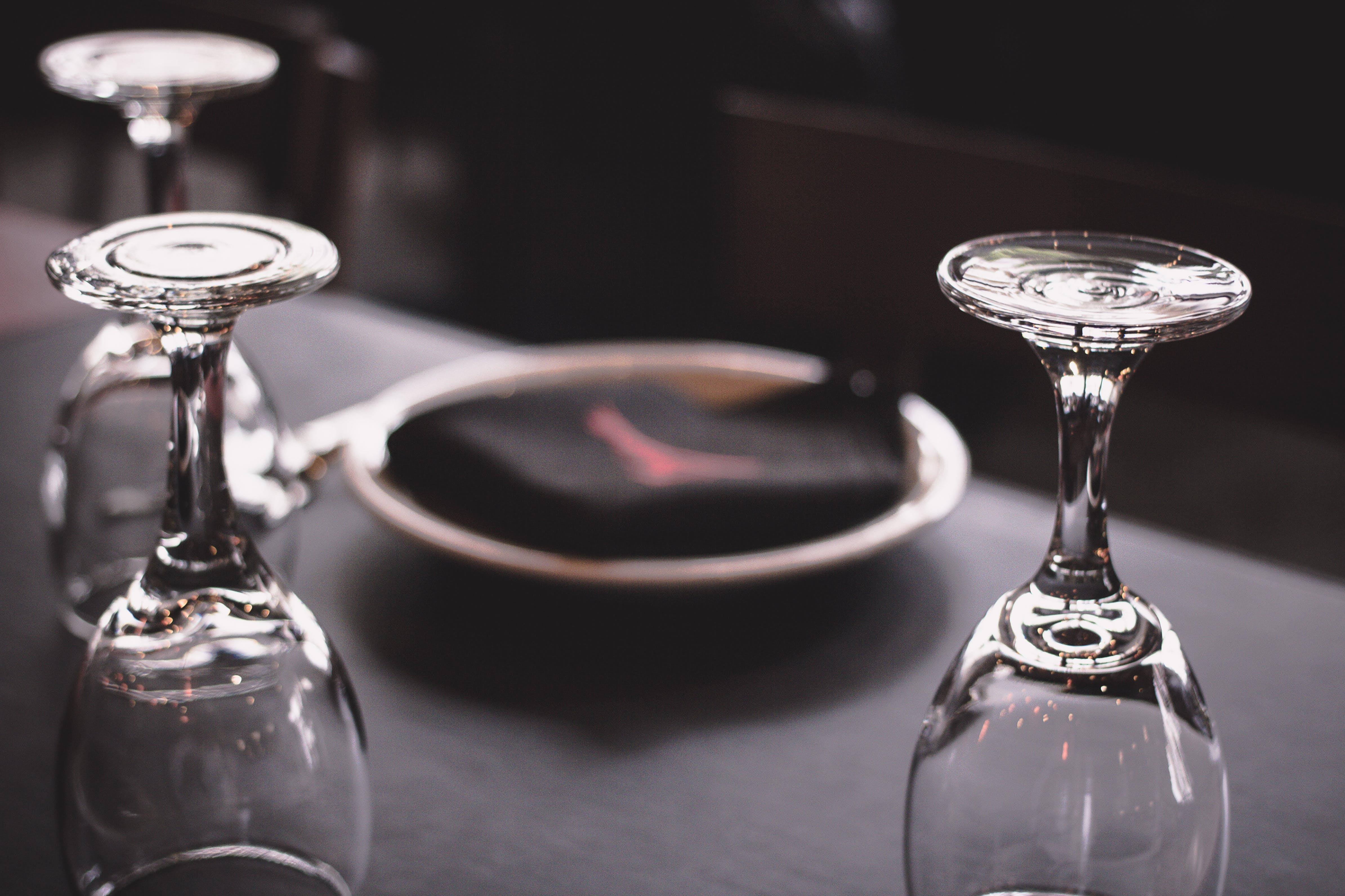 Three Wine Glasses on Black Surface