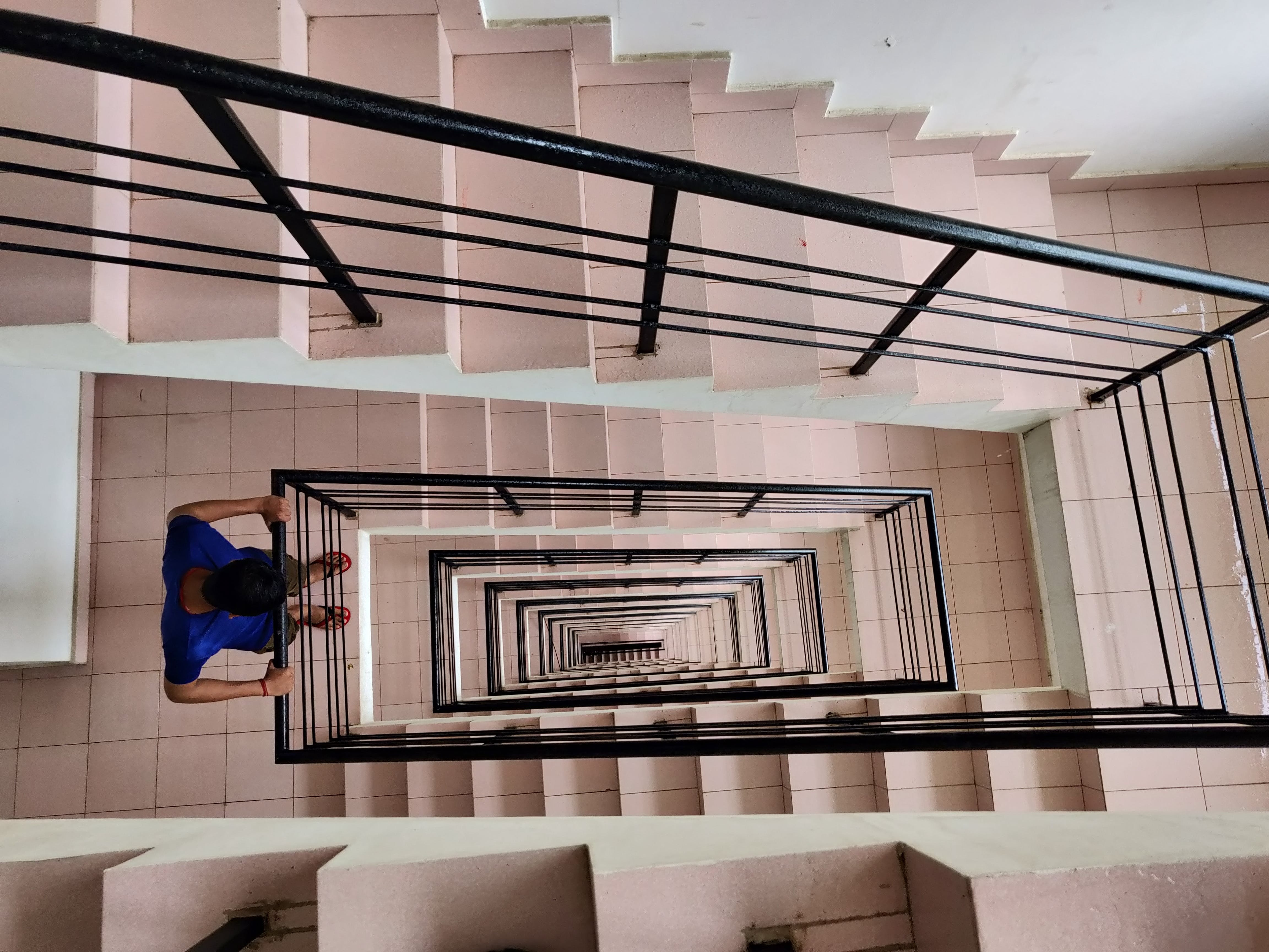 Man Looking Downwards of Stairs