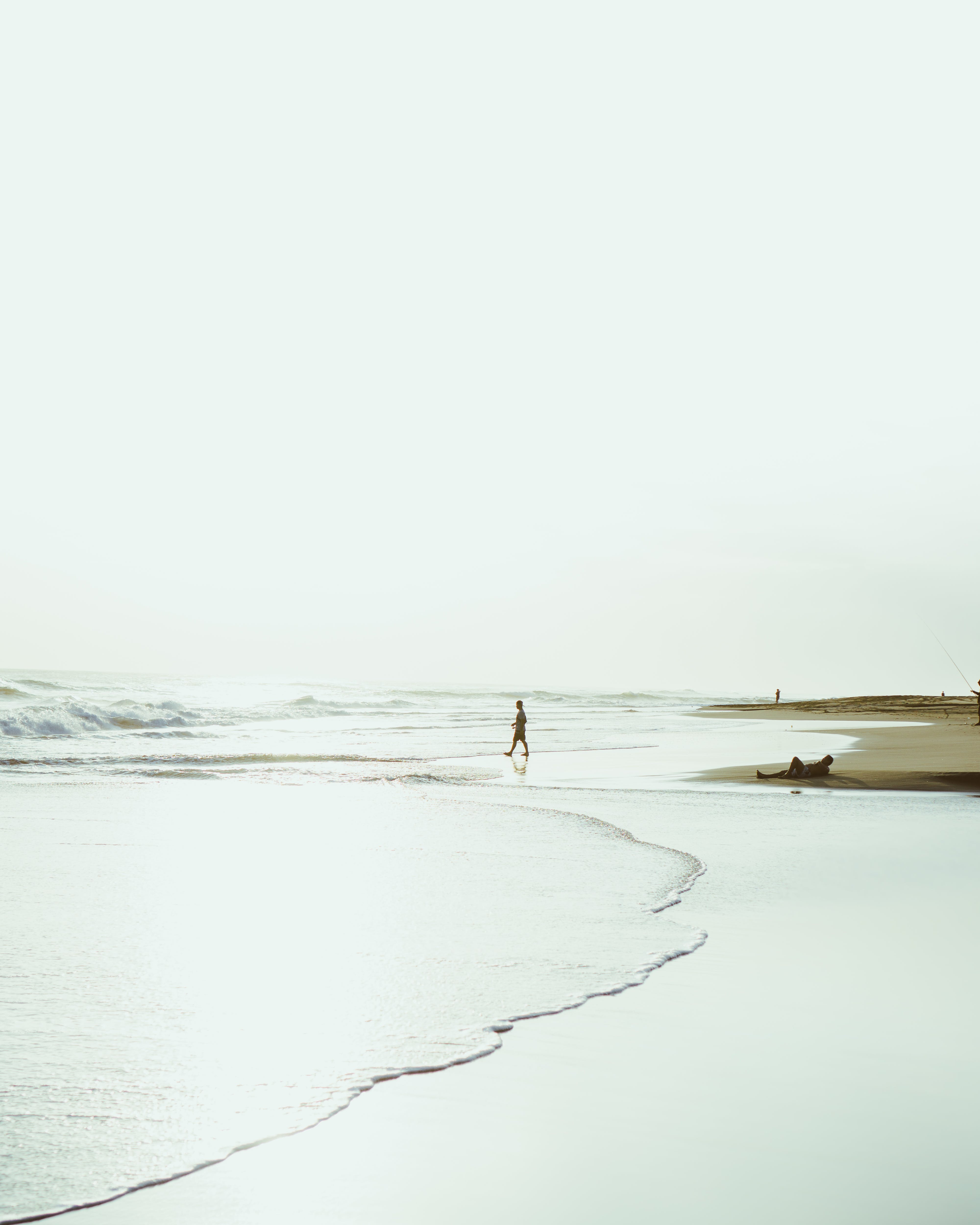 Person Walking At The Beach