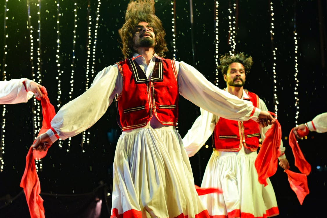 Two Dancing Men on Stage