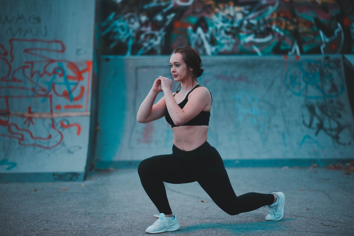 Woman Stretching Beside Wall
