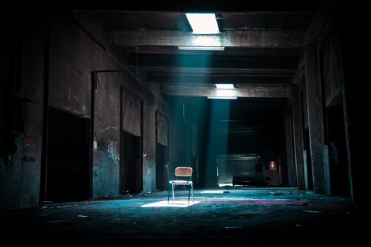Chair on Abandoned Place With a Spotlight Coming from Outside