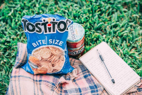 Tostito Pack Beside Can and Notebook