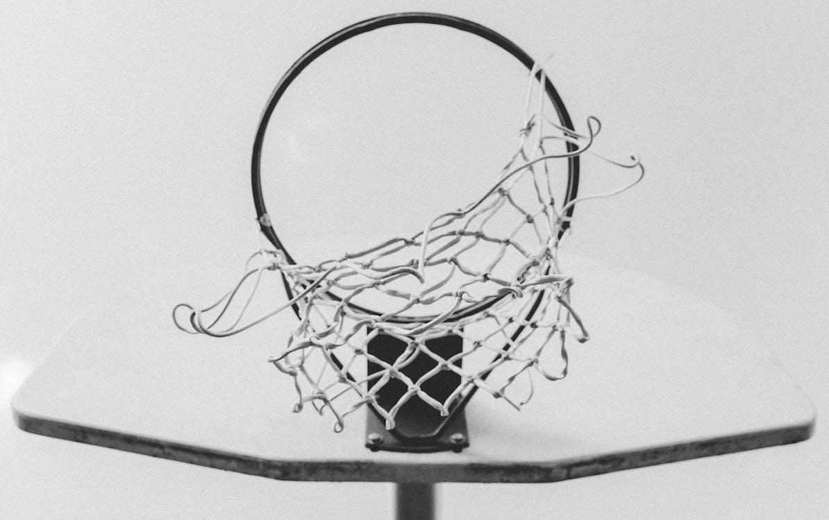 Monochrome Photo of Basketball Ring