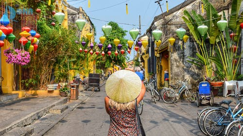 Woman Wearing Straw Hat In The Middle Of Road