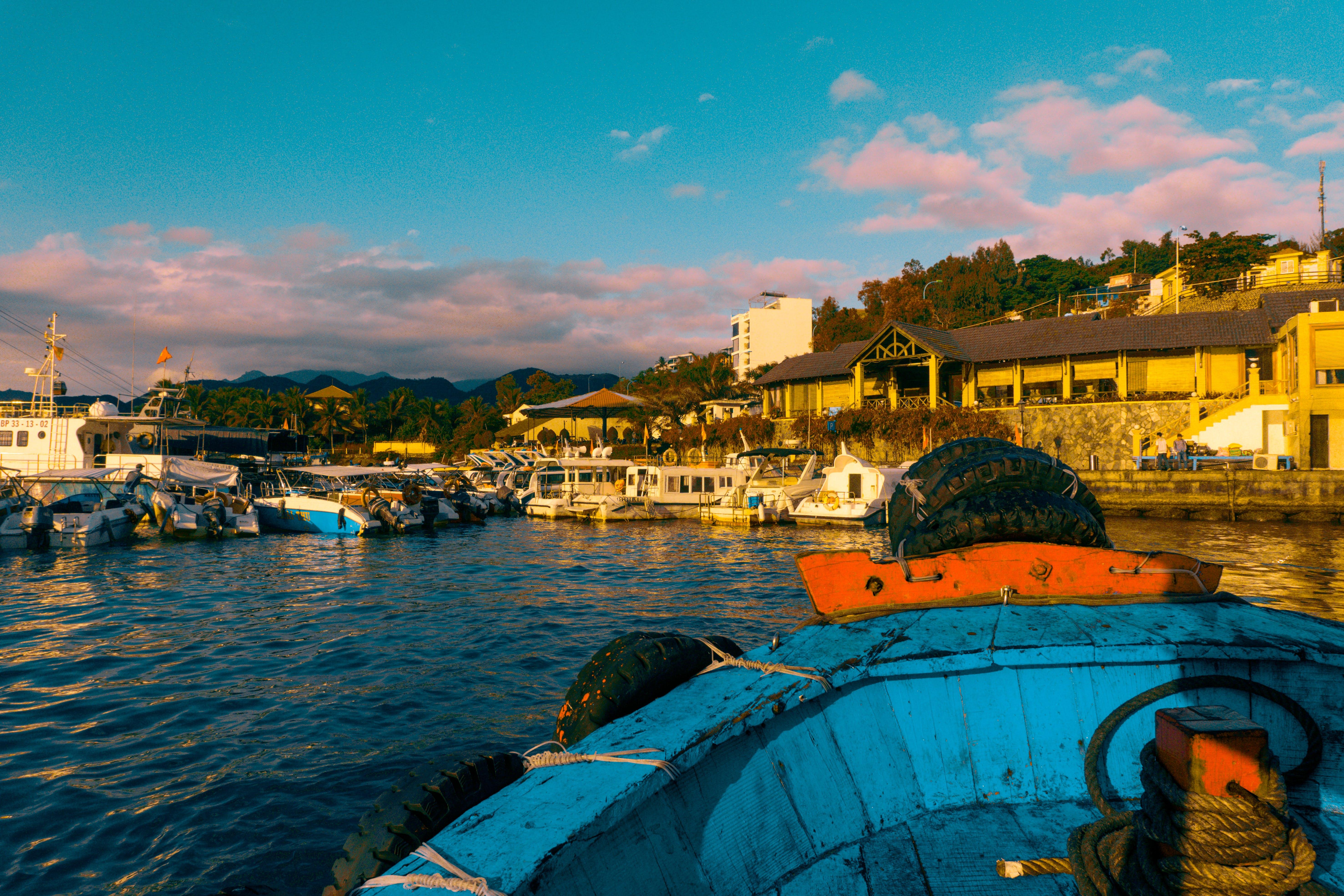 Blue Canoe Near Dock