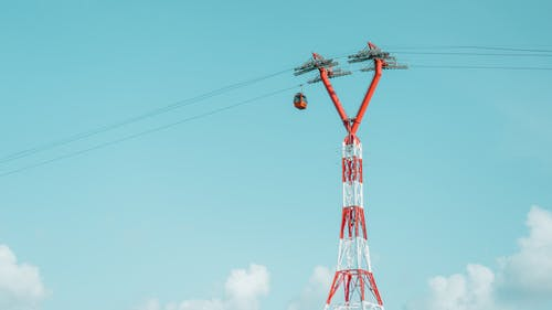 Low Angle Photography of Red and White Utility Tower