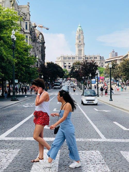 Two Women Crossing on Pedestrian Lane
