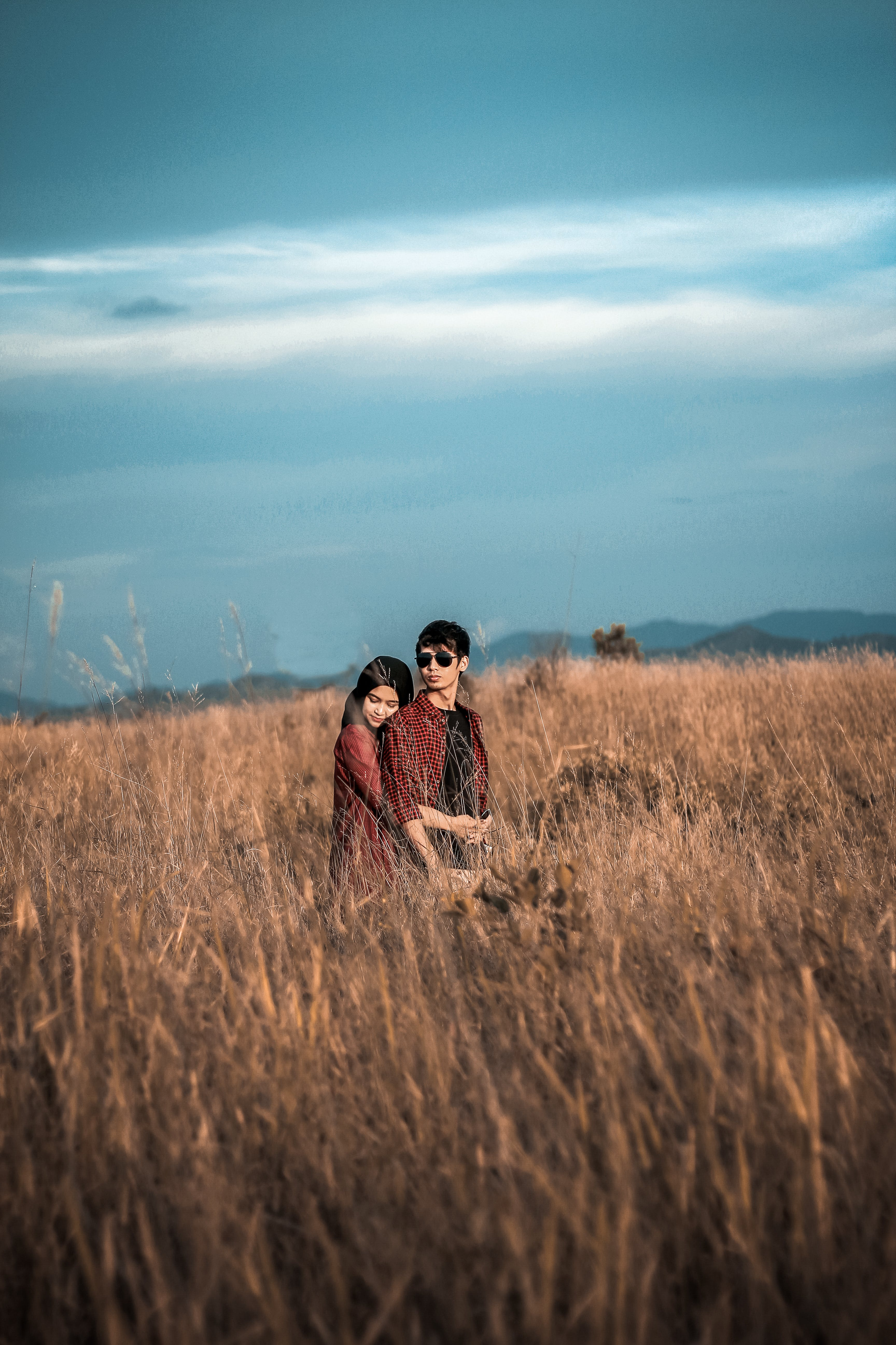 Man and Woman on Grass Field