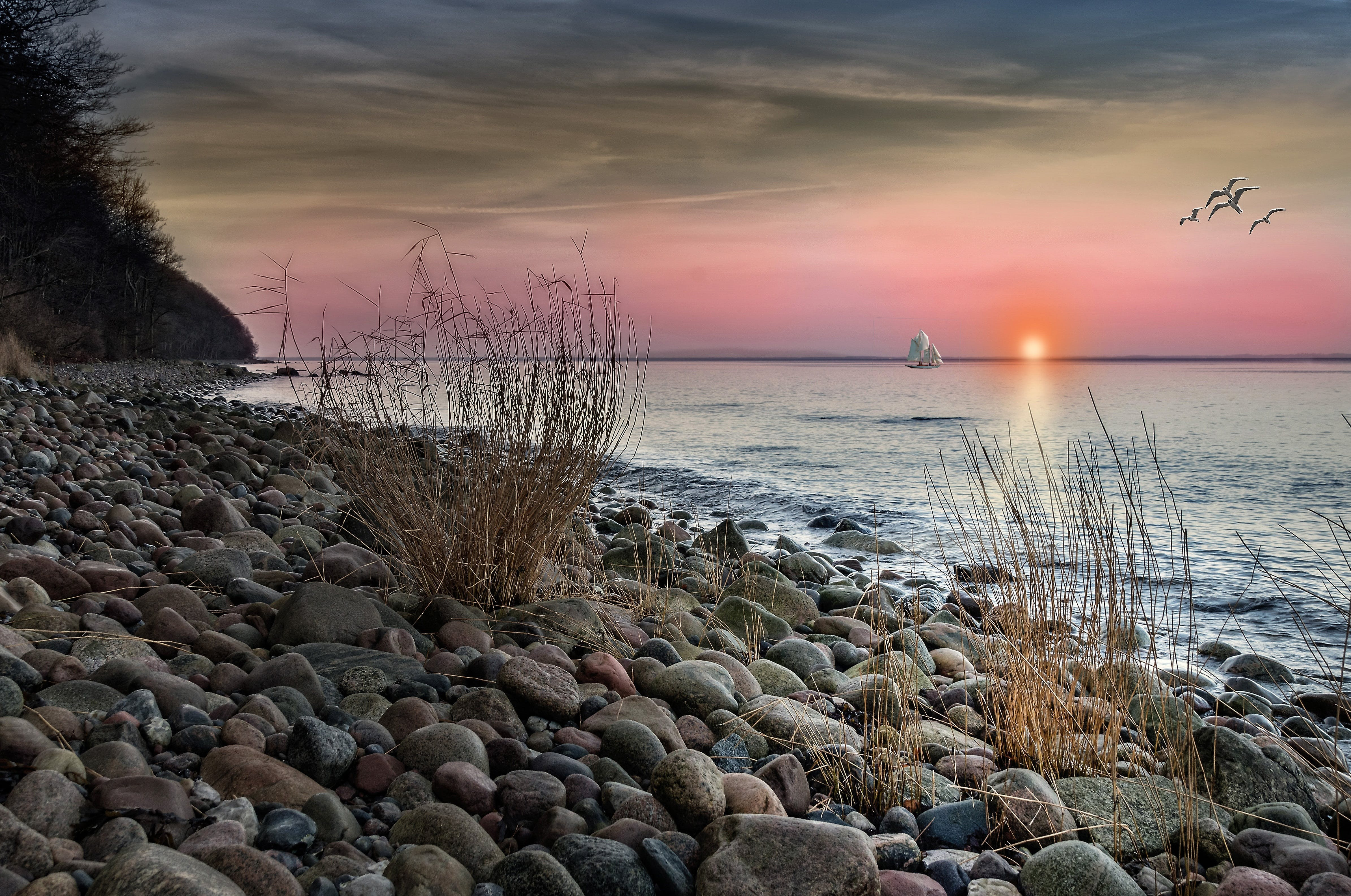 Brown and Grey Stones on Seashore during Sunset