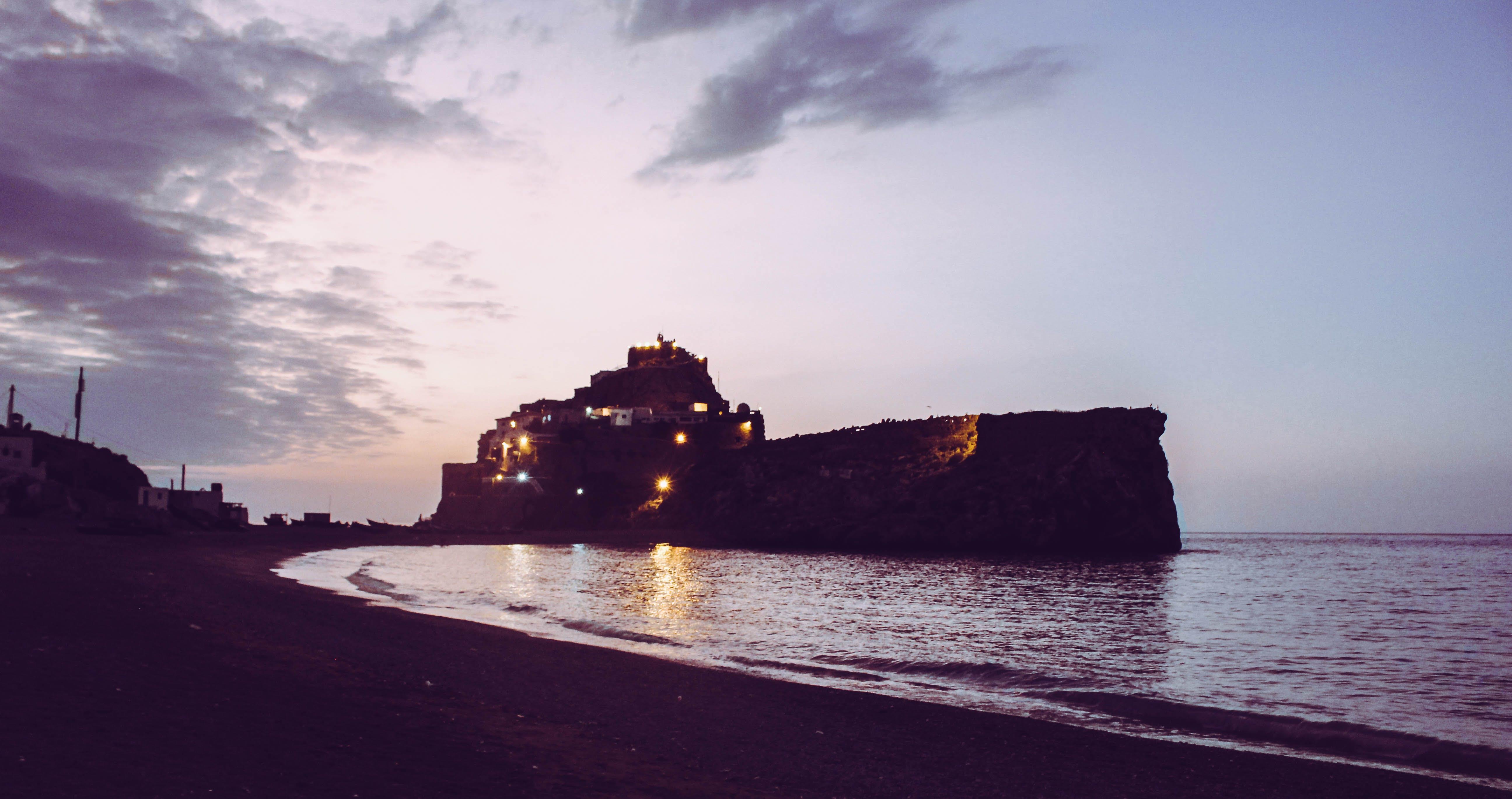 Free stock photo of beach, castle, sunset