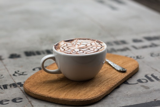 Cappuccino in Ceramic Teacup Beside Teaspoon