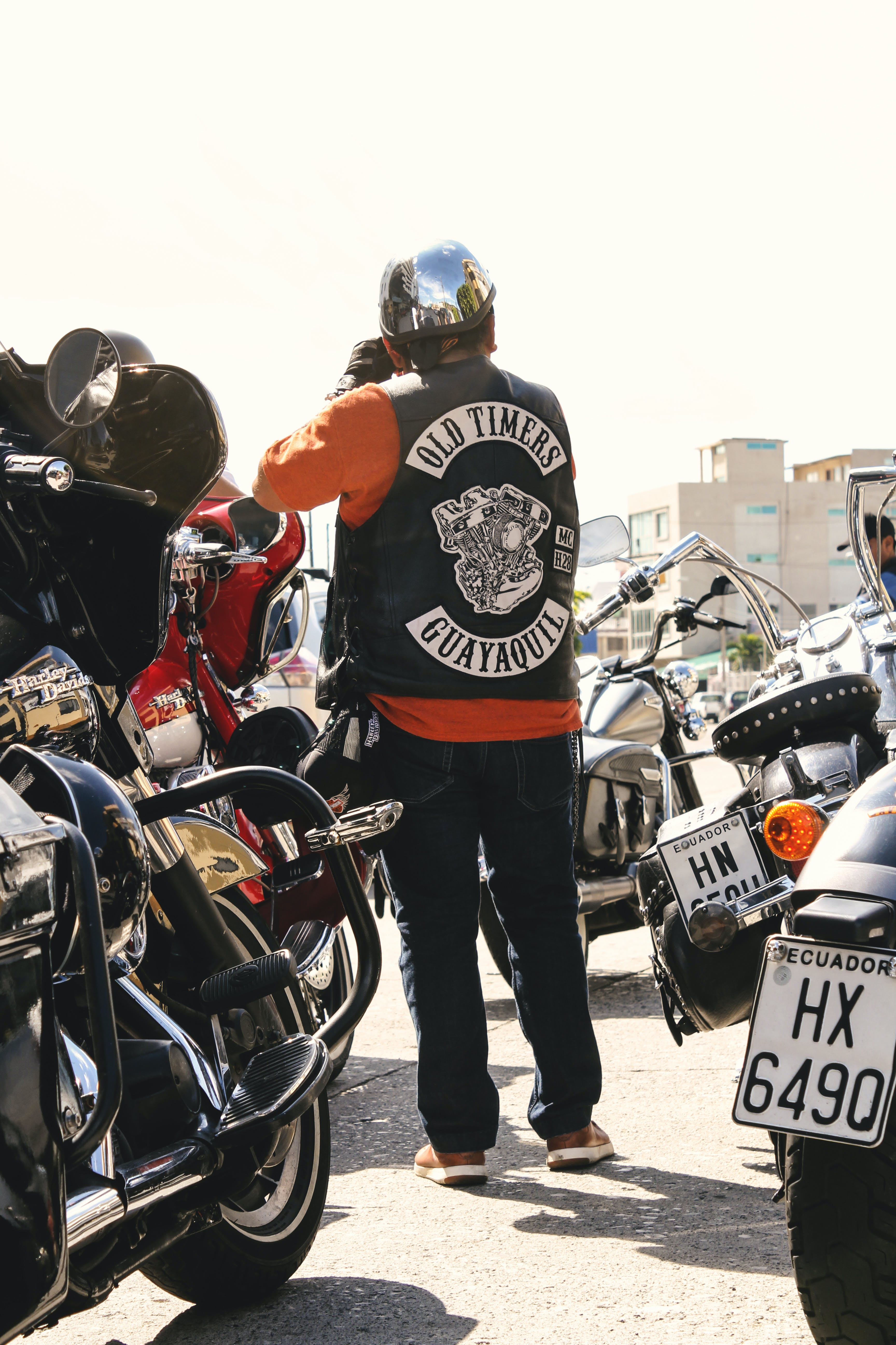 Man Standing Surrounded by Motorcycles