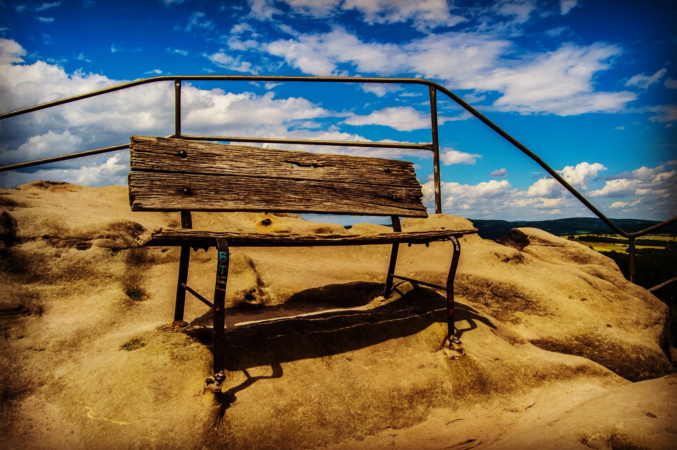 Brown Wooden Bench on Brown Sand