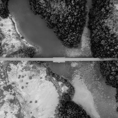 High-angle and Grayscale Photography of Road and Body of Water