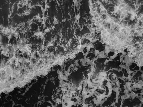Бесплатное стоковое фото с вода, волны, поверхность, размытый фон