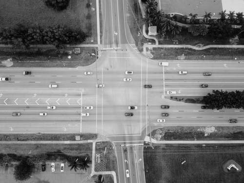 Grayscale Photo of Top View Photography of Road With Vehicles