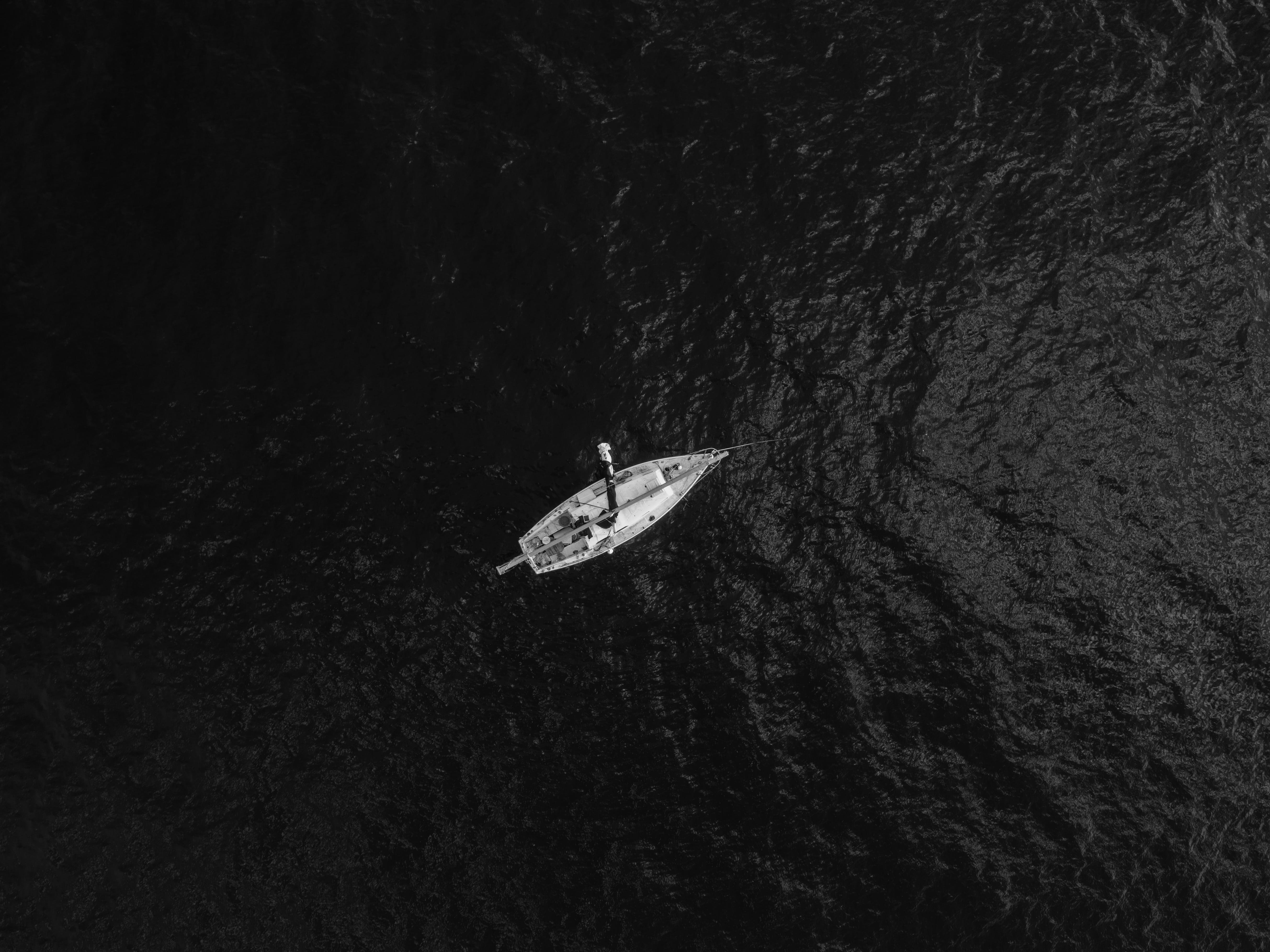 Aerial Photography Of Boat In The Middle Of Body Of Water